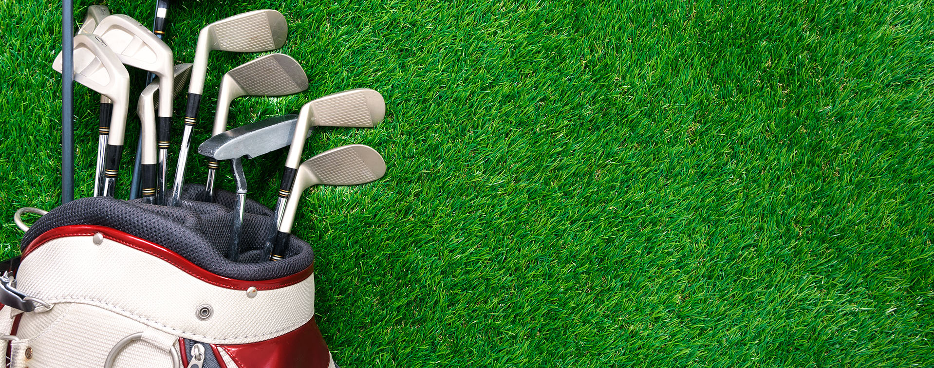 Photo of golf clubs on turf